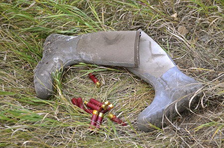 carelessness: Hunting boots and shotgun shells spoiled on the ground.