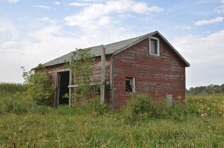 pigpen: Old farm shed which could have been used for animal shelter, granary, storage, or workshop,