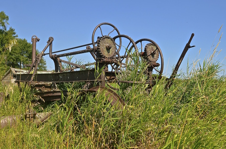 grader: Gears and wheels of an old road grader of gravel surfaces