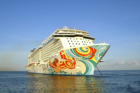 COZUMEL, MEXICO, February 16, 2016: The Norwegian Getaway anchored in the Caribbean Sea belongs to the Norwegian Cruise Line Holdings is a Bermuda-incorporated, US-headquartered company operating cruise ships, and headquartered in unincorporated Miami-Dad