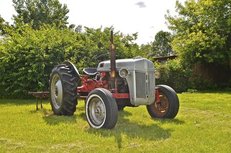 cultivator: STERLING, NORTH DAKOTA, August 10, 2014: The Ford N-Series tractors are a series of farm tractors that were produced by Ford between 1939 and 1952, spanning the 9N, 2N, and 8N models