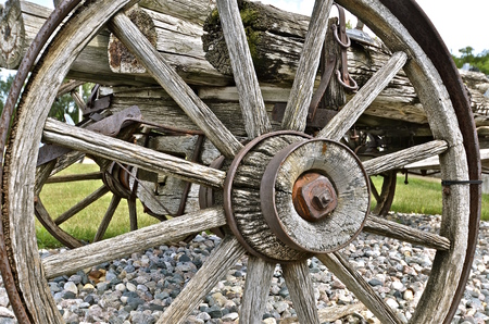 spoked: Wooden spoked wheel and hub of an old wagon trailer
