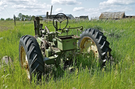 junked: A deserted farmstead finds an old junked tractor left in the long grass