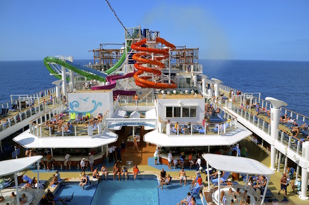 unincorporated: COZUMEL, MEXICO, February 16, 2016: The Norwegian Getaway anchored in the Caribbean Sea belongs to the Norwegian Cruise Line Holdings is a Bermuda-incorporated, US-headquartered company operating cruise ships, and headquartered in unincorporated Miami-Dad