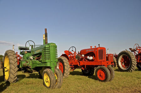 thresh: DALTON, MINNESOTA-Sept12, 2016: John Deere and Allis Chalmers tractors are displayed at the Dalton Threshing Reunion where 1000s attend each 2nd full weekend in September each year.
