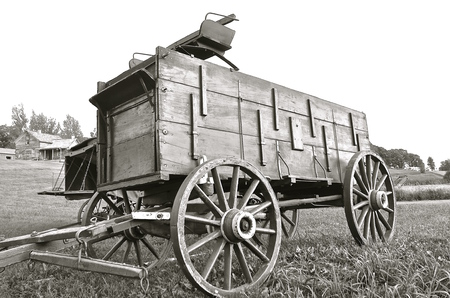 spoked: Old buckboard horse drawn wagon in black and white Stock Photo