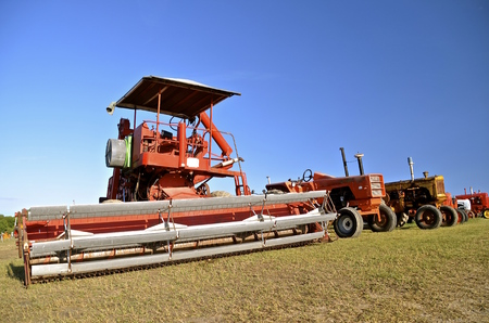 propelled: Self propelled swather with huge header and only an umbrella instead of an air-conditioned, cab.