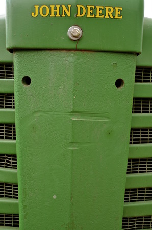 john deere: ROLLAG, MINNESOTA, Sept 3, 2015: The grill of an old tractor is a product of John Deere Co, an American corporation that manufactures agricultural, construction, forestry machinery, diesel engines, and drivetrains Editorial