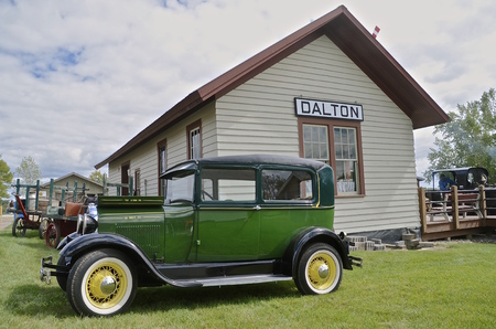 attend: DALTON, MINNESOTA, Sept 10, 2015: A 1928 Model T Ford is parked in from of the Dalton train station at the annual Dalton Steam Threshers Reunion held the 2nd weekend of September when 1,000s attend. Editorial
