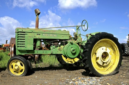deere: June 2, 2014; An old A with a flat tire is a product of John Deere Co, an American corporation that manufactures agricultural, construction, forestry machinery, diesel engines, and drivetrains Editorial