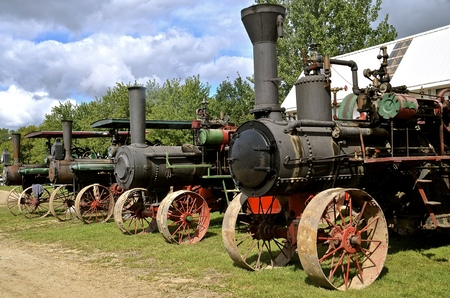 thresh: Line up of old steam engines with huge make stacks