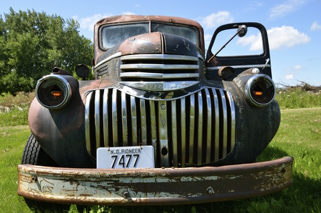 DOWNER, MINNESOTA, August 10, 2014: The old pickup from the 40s is a Chevrolet  colloquially referred to as Chevy and formally the Chevrolet Division of General Motors Company, is an American automobile division of the American manufacturer General Motor Redakční