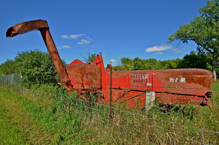DOWNER, MINNESOTA, August 10, 2013: The Massey Fergus tractormachinery name disappeared when a merger of Massey Harris and the Ferguson Company farm machinery manufacturer occurred in 1953