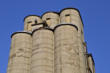bulk memory: Very old poured  circular concrete silos served as storage bins of grain at an elevator