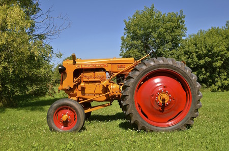refurbished: CLARISSA ,MINNESOTA, August 13, 2015: The restored Minneapolis Moline tractor came from a merger of three companies, Minneapolis Steel & Machinery (MSM), Minneapolis Threshing Machine, and Moline Plow and headquartered in Hopkins, MN.