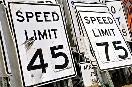 determining: Stacks of traffic signs in storage determining highway speed limits Stock Photo