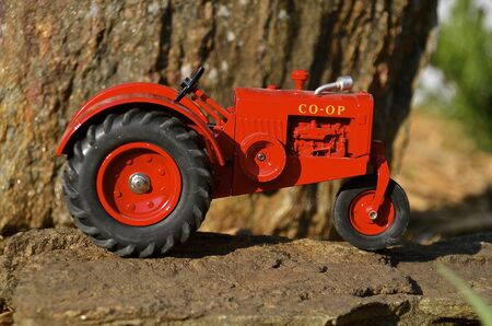 out of production: CHANHASSEN, MINNESOTA-May 13, 2016: The CO-OP brand of tractors was born out of a desire by farmers to reduce cost through collective ownership of machinery production and was eventually bought out by Cockshutt and this toy tractor is a model replica crea