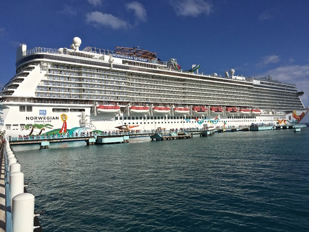 unincorporated: OCHO RIOS, JAMAICA: February 15, 2016: The Norwegian Getaway anchored in the Caribbean Sea belongs to the Norwegian Cruise Line Holdings is a Bermuda-incorporated, US-headquartered company operating cruise ships, and headquartered in unincorporated Miami- Editorial