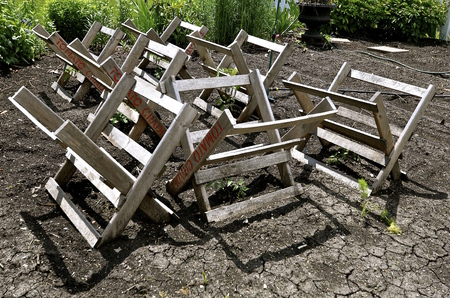 Stock Photo   Tomato Racks Are Positioned In A Garden In Hopes The Baby  Plants Grow And Mature