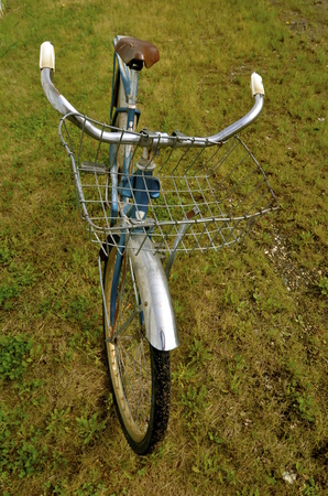 old items: An old classic bike with a huge wire basket for carrying items