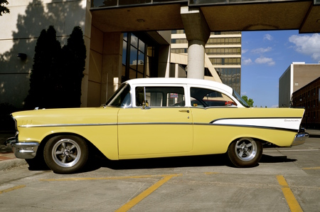 chevy: FARGO, NORTHDAKOTA, June 1, 2016: The yellow �57 Chevy is found in downtown Fargo where �Cruising Broadway happens every first first  Thursday night of the month  from June through September where old cars are featured.