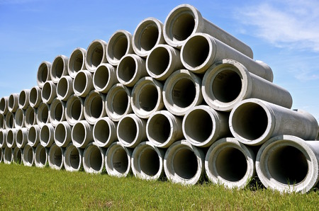 A row of huge concrete culverts for engineering industrial projects where underground water diversion is necessary Stock Photo