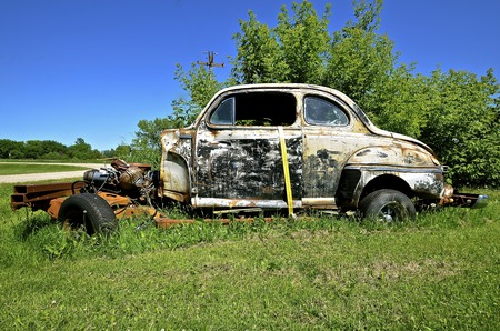 An old coup has been turned into a hot rod with a missing front end. Stock Photo