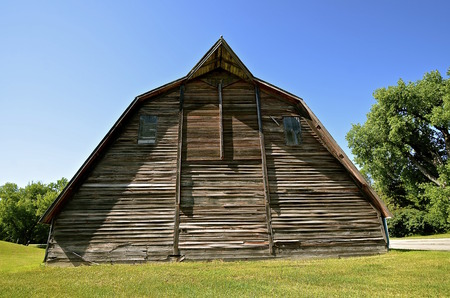 lowered: An old dairy barn has been, lowered, leaving only the hay loft as the main level. Stock Photo