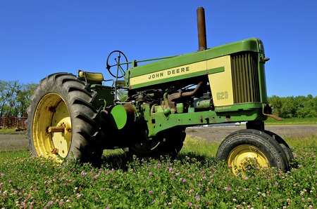 john deere: HENDRUM, MINNESOTA, June 15, 2016 ;The 620 two cylinder tractor is a product of John Deere Co, an American corporation that manufactures agricultural, construction, forestry machinery, diesel engines, and drivetrains.