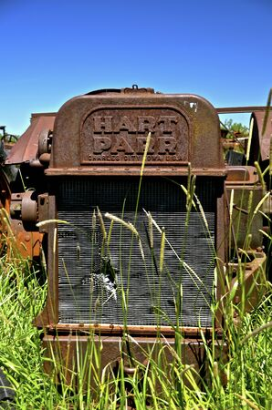 BARNESVILLE, MINNESOTA, June 25, 2014: The old rusty Parr comes from Hart-Parr Tractor Company which began operations in 1897 and sold out to Oliver Tractor company in 1929