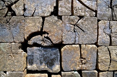 creosote: Pile of old creosoted ends of wooden railroad ties displaying the metal cleats and cracks. Stock Photo