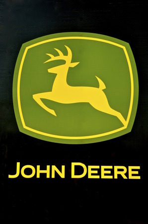 deere: MOORHEAD, MINNESOTA, July 24, 2016: The running deer and the John Deere words make up the logo for the John Deere Co, an American corporation that manufactures agricultural, construction, forestry machinery, diesel engines, and drivetrains. Editorial