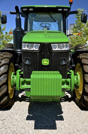 john deere: MOORHEAD, MINNESOTA, July 25, 2016: The new tractor with front end weights is a product of John Deere Co, an American corporation that manufactures agricultural, construction, forestry machinery, diesel engines, and drivetrains.