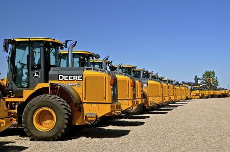 loaders: MOORHEAD, MINNESOTA, July 25, 2016: The new huge wheel loaders are products of John Deere Co, an American corporation that manufactures agricultural, construction, forestry machinery, diesel engines, and drivetrains.