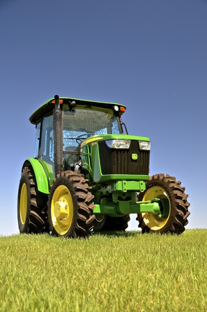 john deere: MOORHEAD, MINNESOTA, July 25, 2016: The new 5075E tractor is a product of John Deere Co, an American corporation that manufactures agricultural, construction, forestry machinery, diesel engines, and drivetrains.