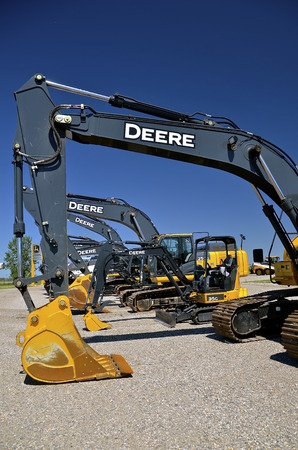 john deere: MOORHEAD, MINNESOTA, July 25, 2016: The new backhoes are products of John Deere Co, an American corporation that manufactures agricultural, construction, forestry machinery, diesel engines, and drivetrains.