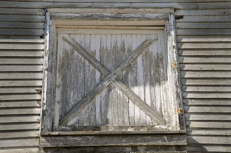 Peeling paint of a hay loft door on on an old white barn. & Hay Loft Stock Photos. Royalty Free Business Images