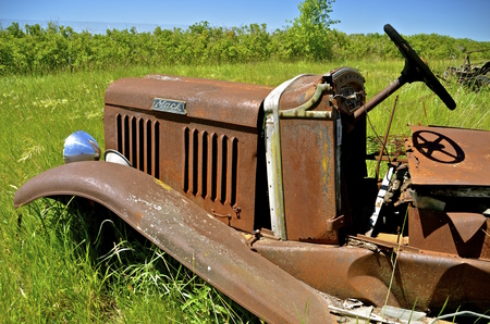 mack: BARNESVILL, MINNESOTA, June 19, 2016, The grill and steering wheel of an old Mack truck, a company founded in 10900, had its first truck produced in 1907.