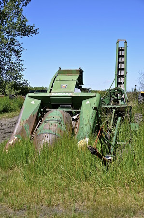 Barnesville, MINNESOTA-June 19, 2016: The old Oliver salvageable two row corn picker was from the  Oliver Farm Equipment Company which was purchased by White  Motor Corporation in 1960.