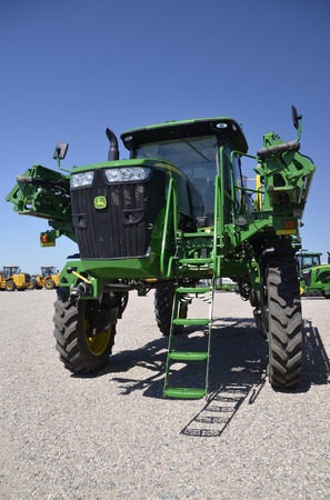 john deere: MOORHEAD, MINNESOTA, July 25, 2016: The new sprayer tractor is a product of John Deere Co, an American corporation that manufactures agricultural, construction, forestry machinery, diesel engines, and drivetrains.