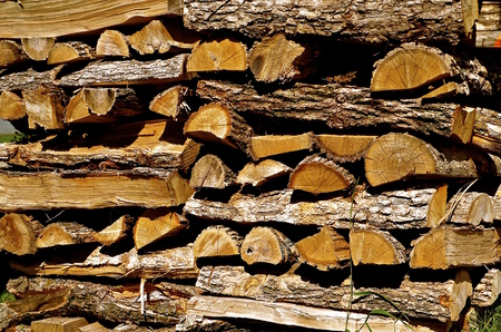 A stacked pile of split firewood drying in storage Stock fotó