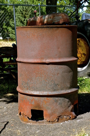 Old rusty farm burn barrel to dispose of garbage and rubbish 版權商用圖片