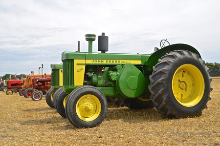 ROSHOLT, SOUTH DKOTA, August 21, 2015: A long row of tractors featuring the 720 restored John Deere at the annual Rosholt Area Threshing Bee held the third full weekend of August.