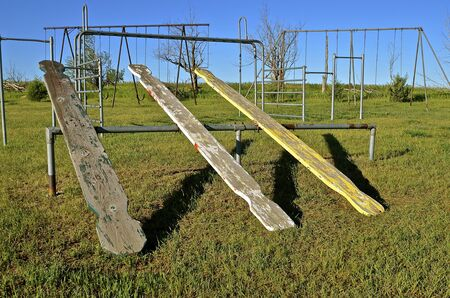 teeter: Teeter totters and swing sets on a school playground
