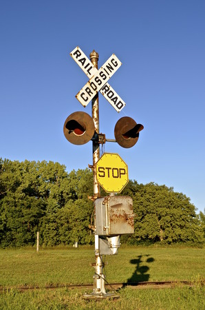 crossbars: An old vintage railroad crossing sign with no crossbars Stock Photo