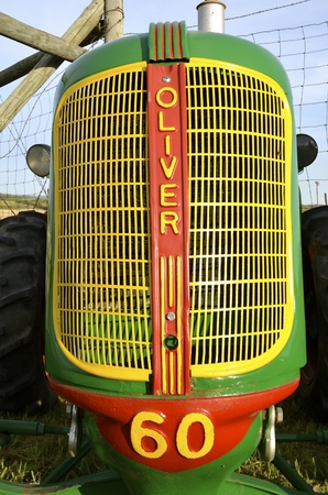 implementing: ROLLAG, MINNESOTA, Sept 1, 2016: An old restored Oliver 60 tractor and grill is displayed at the West Central Steam Threshers Reunion(WCSTR) where 1000s attend each Labor Day weekend in Rollag, MN each year.