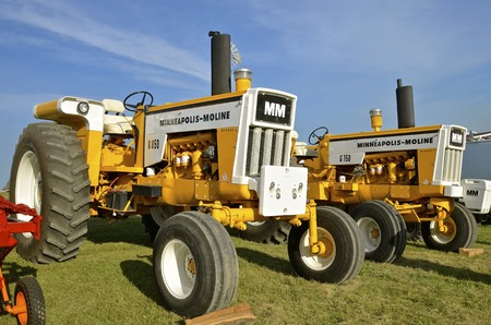refurbished: ROLLAG, MINNESOTA, Sept 1, 2016: Minneapolis Moline G750 and G850 tractors are  parked at the West Central Steam Threshers Reunion(WCSTR) where 1000s attend each Labor Day weekend in Rollag, MN each year.
