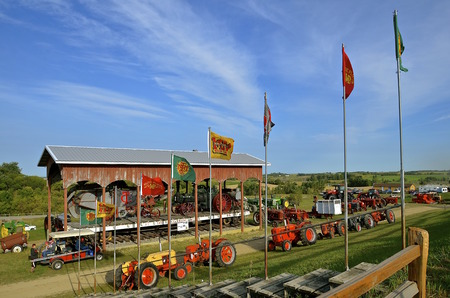 ROLLAG, MINNESOTA, Sept 1, 2016: Tractors of many models and flags are displayed at the West Central Steam Threshers Reunion(WCSTR) where 1000s attend each Labor Day weekend in Rollag, MN each year. Editorial