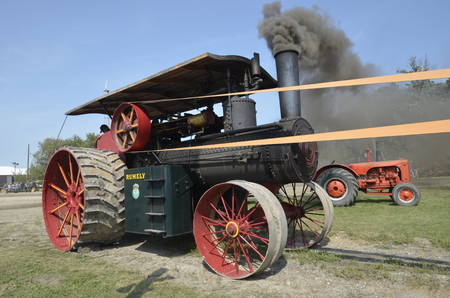 ROLLAG, MINNESOTA, Sept 1: A  Restored  and running Rumely steam engine at the West Central Steam Threshers Reunion(WCSTR) where 1000s attend each Labor Day weekend in Rollag, MN each year. Editorial