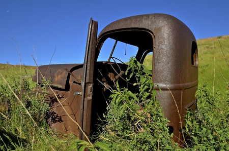 oldie: WATFORD CITY, NORTH DAKOTA, June 24, 2016: The old rusty International pickup is a product of The International Harvester Company which was a United States manufacturer of agricultural machinery, construction equipment, trucks, and  formed In 1902